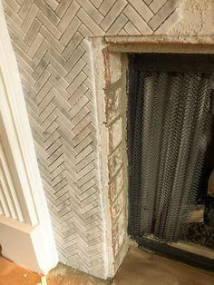 How to Add Herringbone Marble Tile to a Fireplace - Southern Hospitality Southern Sayings, Southern Girls, Southern Living, Tile Around Fireplace, Fireplace Surrounds, Fireplace Remodel, Fireplace Ideas, Southern Belle Secrets, Cowgirl Quote