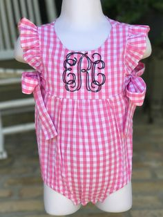 This gingham bubble is trimmed with ruffled sleeves and two ties on either side. It comes with a custom monogram in the font and monogram color of your choice. How to order: 1. Choose the size 2. Choose the monogram color 3. In the note to seller section, include the monogram or name you want in the order you want it to be listed along with the font choice  *pictured is the navy monogram thread and vintage vine font