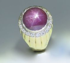 Star Ruby and Diamond 18ct mens ring with 19 carat round cabochon cut, well-defined star sapphire.