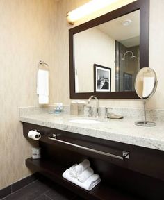 """•3/4"""" granite vanity tops w/ 1 1/2"""" laminated flat polished and eased •4"""" height backsplash, left and right side splashes •White ceramic bowl undermount •Brass faucet  •Stainless steel towel bar installed on the front apron"""