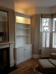 Alcove Designs is the fitted furniture specialist in London. Bespoke alcove furniture, cabinets and wardrobe design and installation, for homes and offices. Living Room Built Ins, Living Room Shelves, Living Room Storage, Living Room With Fireplace, Home Living Room, Living Room Designs, Alcove Cupboards, Built In Cupboards, Victorian Living Room