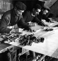 From Robert Doisneau's studies of the weavers of Aubusson, men weaving a tapestry - 1945. I love the collection of tools displayed.