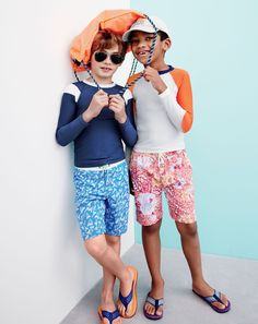 J.Crew boys' long-sleeve rash guard, nylon swim shorts in shark tooth, drawstring backpack in neon papaya, and mixed geo flip-flops.