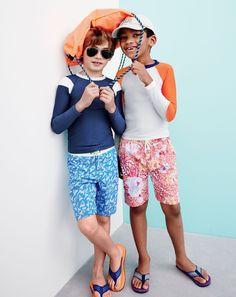 J.Crew boys' long-sleeve rash guard, nylon swim shorts in shark tooth, drawstring backpack in neon papaya, and mixed geo flip-flops.