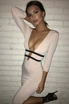 Emily Ratajkowski Emily Ratajkowski makes a bold statement in a fitted pink Nookie dress with a plunging neckline at the Svedka Vodka Broken Resolution's bash in Los Angeles on Tuesday.