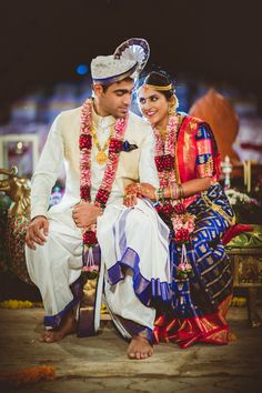 South Indian Brides - Bride in a Red and Blue Kanjivaram Saree with the Groom in a White Dhoti Kurta | WedMeGood #wedmegood #indianbride #southindianbride #southindiancouple #kanjivaram #red #blue