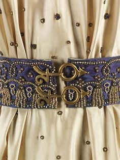 Schiaparelli belt and dress from the Zodiac collection