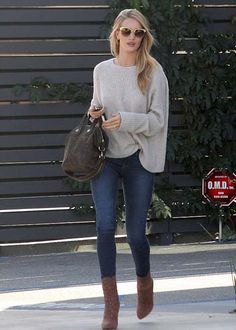 Rosie Huntington-Whiteley was spotted wearing skinny Paige Denim jeans, a cozy Zadig & Voltaire sweater, a Jennifer Fisher necklace, an Anita Ko ring, Alaia booties and a Givenchy purse.