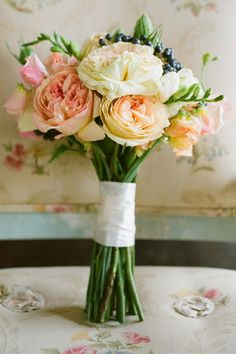 I love the height of this bouquet... balanced out by the robustness of the flowers.