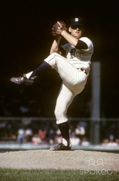 Detroit Tigers.....Denny McLain He won 31 games, losing only 6 in 1968, they beat the St. Louis Cardinals on the road, World Series Champions!