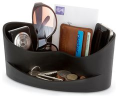 Home AccessoriesPrice: GBP  17.99 | Visit Store »Casa Organiser is a stylish and useful storage solution that keeps all your essentials together in one place. The organizer stores everything you need on a daily basis including your wallet or purse, mobile phone, ipad, keys and sunglasses.