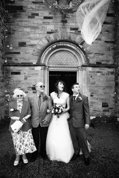 One of my favourite shots. The brides veil being blown off in the wind, their reaction is priceless.