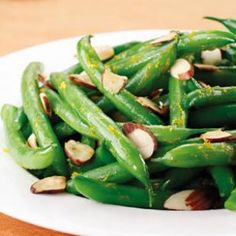 Orange-Scented Green Beans with Toasted Almonds  Toasted nuts and fresh orange zest adorn these versatile green beans. Toast the nuts while you steam the beans and you have a polished addition to any meal ready in 15 minutes flat. Double it: Steam the green beans in a Dutch oven instead of a saucepan.
