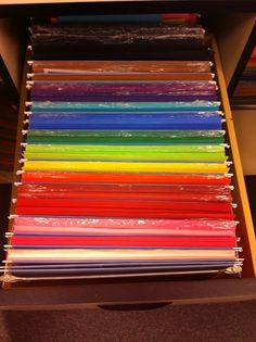 Organize construction paper in hanging files to eliminate messy stacks of paper.  Great idea!