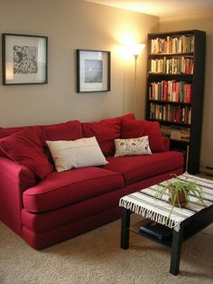 Red couch, light floors, dark furniture. This is the theme we are working toward.