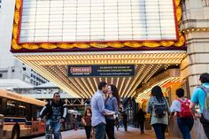 Summer engagement session underneath the Chicago Theatre with accidental photobomber by documentary wedding photographer Emma Mullins Photography