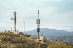 Telecommunication (GSM) towers with TV antennas by deyangeorgiev. Telecommunication (GSM) towers with TV antennas on the mountain Communication Tower, Technology Photos, Mobile Learning, Towers, Stock Photos, Tv, Innovation News, Mountain, Mobile Phones
