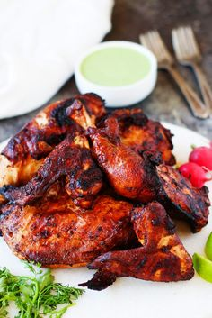 This Peruvian Grilled Chicken with Creamy Green Sauce is packed with flavor and the perfect way to add some international flair to your next barbecue   platingsandpairings.com