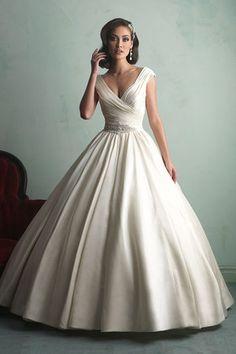Stunning v-neck ballroom gown by @allurebrudals!