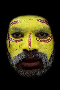 Huli warrior yellow face, Papua New Guinea, by Eric Lafforgue