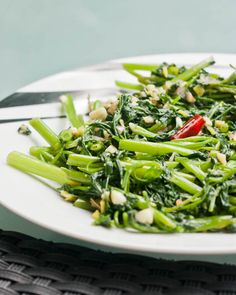 Stir Fried Morning Glory, I love morning glory. Also called Kang Kong. This is usually how we cook it, but added a little more fish and oyster sauce and lots of garlic.