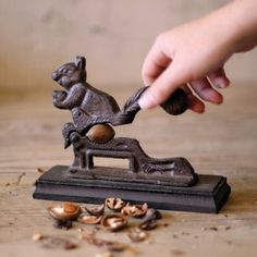 Find it at the Foundary - Cast Iron Squirrel Nut Cracker SOLD OUT but so cute. I want it. Only $13.00 too.