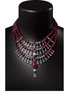 CARTIER. Necklace platinum, one 17.45-carat ruby from Tadjikistan, one 3.17-carat F VS2 briolette-cut diamond, one 2.01-carat H VVS1 rose-cut diamond, one 12.04-grain natural pearl, fourty-one natural saltwater pearls totaling 64.72 grains, ruby beads, calibrated rubies, onyx, brilliant-cut diamonds.
