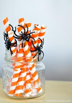 Plastic spider rings around straws for halloween! Pottery Barn Kids Halloween Party by Kara Allen of Kara's Party Ideas KarasPartyIdeas.com #potterybarnkids #halloween #halloweenparty