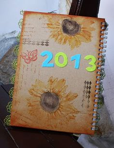 Use a sketchbook for the guestbook? Laura draws cover?