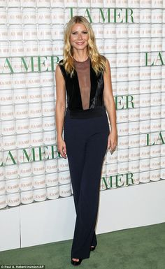 Fashion risks: Actress Gwyneth Paltrow looked stylish in a jumpsuit with a see-through front panel as she attended a party to mark 50 years of luxury skincare line La Mer in Los Angeles on Tuesday