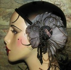 1920s inspired headband with feathered flower and black rhinestones
