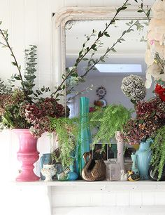 colorful glassware and florals on mantle. / sfgirlbybay
