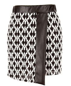 Winning Streak Skirt: Features a beautiful mock wrap design, supple faux-leather trim, bold monochrome deco print throughout, and an edgy asymmetrical front to finish.