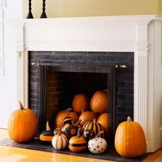 Pumpkins spilling out of the fireplace: I think this is kind of funny... and fantastic!  You could get those cheapie fake pumpkins from Michael's and go crazy!