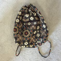 Vera Bradley Drawstring This is the brown pattern, it is in excellent condition. The only problem would be the back clasp thing that draws the bag shut is coming apart a little at the seam, nothing that can't be fixed with sewing. Very cute on and holds a lot! Vera Bradley Bags