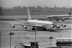 Boeing 707 of SAA, Suid Afrikaanse Lugdiens. Air Canada DC-8 in the background, at Heathrow. One of these SAA Boeings is ZS-CKE, around 1963 - Nick Denbow