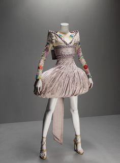 Alexander McQueen                                           It's Only A Game, spring/summer 2005               Dress and obi-style sash of lilac and silver brocade; jacket of lilac silk faille embroidered with silk thread; top of nude synthetic net embroidered with silk thread