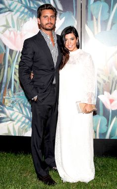 Airy Gown from Kourtney Kardashian's Mommy Style  Kourt stands by her man in an airy white maxi.