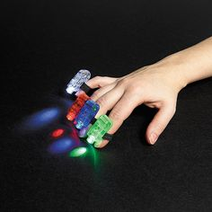You won't know what to point at first with these cool and colorful finger lights. Pass these mini lights out as Halloween candy alternatives or as party . Glow Stick Party, Glow Sticks, Laser Tag Birthday, Reading Incentives, Roller Skating Party, Finger Lights, Teen Birthday, Birthday Parties, Birthday Ideas