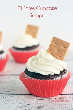 Delicious S'Mores Cupcake Recipe. Has everything that a S'more should have, but in cupcake form! Chocolate Cupcakes with Marshmallow Frosting. Garnished with a Graham Cracker.