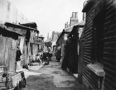 Woodlands Cottages, Camberwell in South London. Photograph by Edward G Malindine. Victorian London, Vintage London, Old London, Woodlands Cottage, Forest Hill, South London, Slums, London Street, British Isles
