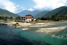 Drangme Chhu River, Bhutan. I must go before I die. The only country in the world that counts Gross National Happiness over GDP. Between China and India, next to the Himalayas... I wonder how these cultures intertwine. :) *In love*