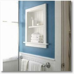 Bathroom niche lined with beadboard.