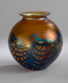 Amber Wave Vase by Carl Radke. Stunning blown glass vase in amber tones with a wave pattern.