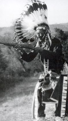 Stump Horn holds a carbine he captured at the Battle of the Little Bighorn
