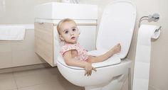 Little girl in toilet