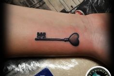 A tattoo key is a good suggestion for your small tattoo. A tattoo small created by Acanomuta Tattoo Studio.