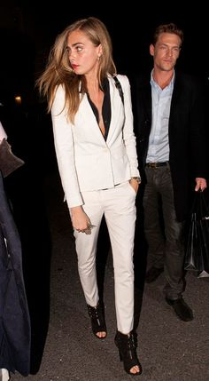 Cara Delevingne in a white suit with a black shirt underneath