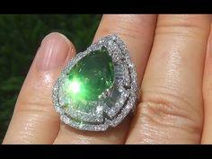 An astonishing pear shaped Tsavorite Garnet and Diamond ring. Make sure to watch the video.