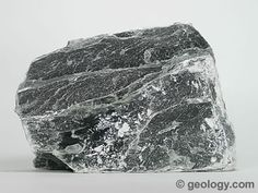 """Talc: Foliated talc that has a black color in massive form but cleaves into thin, flexible, inelastic and colorless sheets. Talc: A Mineral in Your Daily Life  Most people are familiar with the mineral talc. It can be crushed into a white powder that is widely known as """"talcum powder."""" This powder has the ability to absorb moisture, absorb oils, absorb odor, serve as a lubricant, and produce an astringent effect with human skin. These properties make talcum powder an important ingredient in…"""